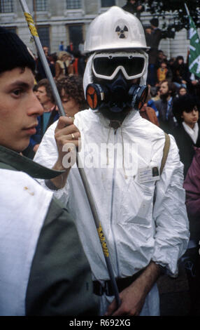 Anti-nuclear Demonstration in London in the 1980's with protester wearing white boiler suit and nuclear white helmet - Stock Image