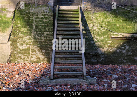 Steps from the shore of the River Thames that lead up to the Thames Path in London, UK. - Stock Image