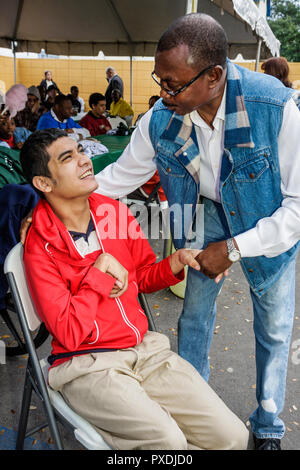 Miami Florida Association for Development of Exceptional ADE MLK Day Carnival developmentally disabled mental mentally physicall - Stock Image