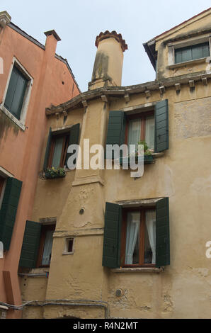 A house with Venetian chimney in Venice Italy - Stock Image