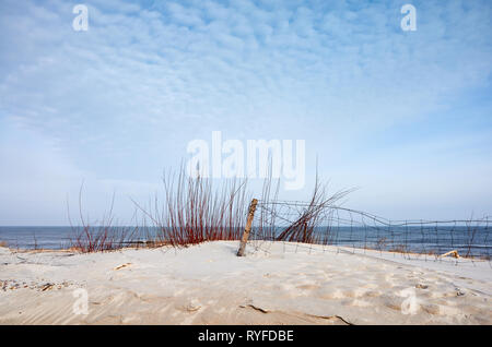 Landscape with fence on a beach dune. - Stock Image