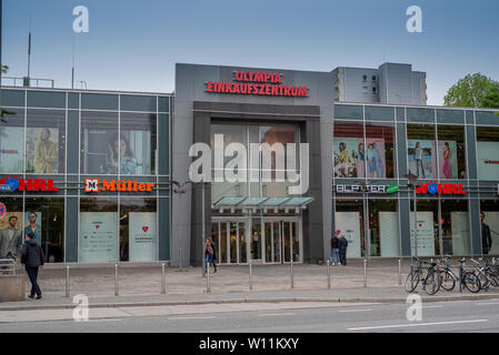 Munich, Bavaria, Germany - May 28, 2019. Front facade of a Olympia, a large Shopping Mall with many retail stores - Stock Image