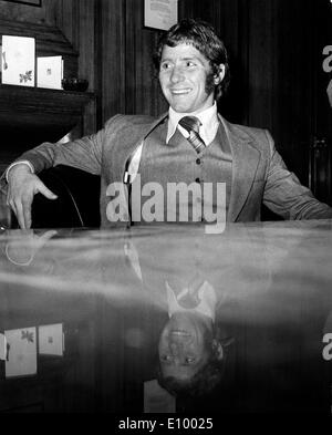 Dec 22, 1971; Highbury, UK; The Everton and ENgland footballer, ALAN BALL, signed for Arsenal F.C. this evening for a British record fee of over 200,000 pounds. The 26 year old World Cup Star arrived at Highbury this evening with his father, Preston Manager Alan Ball. The picture shows a refected smile from ALAN BALL after the signing today at the Arsenal F.C. Highbury. - Stock Image