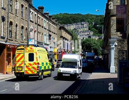 Ambulance in Market Street, Hebden Bridge, West Yorkshire, England UK - Stock Image