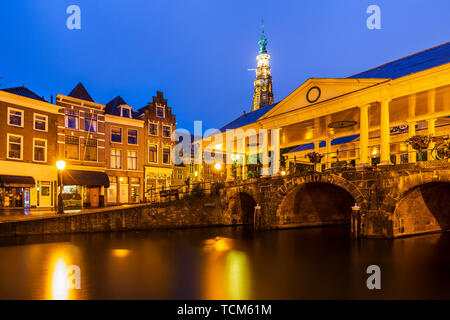 Historical, touristic Dutch town Leiden city hall koornbrug and canals during dusk - Stock Image
