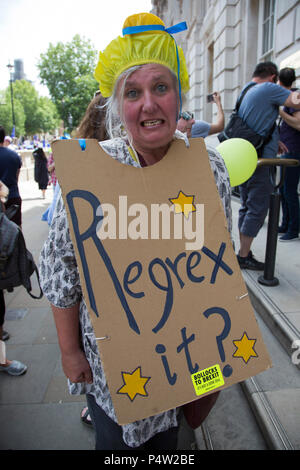 London, UK. 23 June 2018.Anti-Brexit march and rally for a People's Vote in Central London. Woman with a Regrex it? sign. - Stock Image