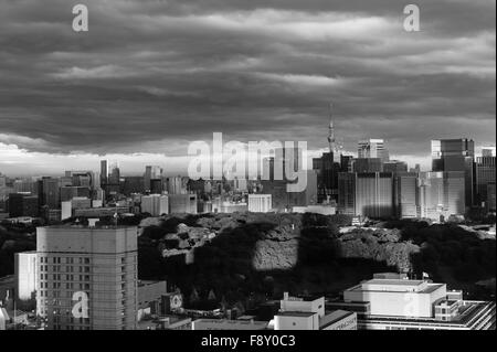Shadows pointing at the Tokyo Sky Tree over the Imperial Palace under a stormy sky - Stock Image
