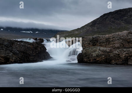 Flowing mountain river, Kungsleden Trail, Lapland, Sweden - Stock Image