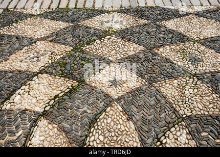A beautiful pattern of light and dark color stones outside the Vanderbilt Museum in Centerprot, Long Island, New York. - Stock Image