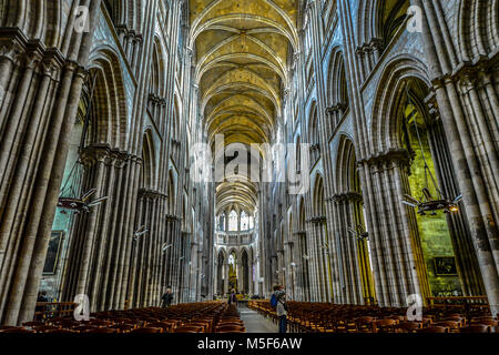 The gothic interior and nave of the Rouen Cathedral in Rouen France with it's high ceilings and vaults - Stock Image