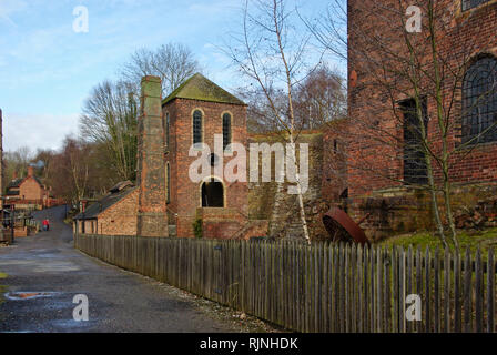 Victorian era blast furnaces, the centre one looking like a startled face, at Blists Hill Victorian Town, Shropshire, England, UK - Stock Image