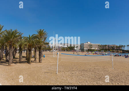 Javea Spain Playa del Arenal beach in summer with volleyball net blue sky sea and people, also known as Xabia - Stock Image
