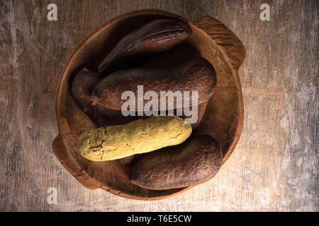 stinking toe fruit closeup in rustic bowl - Stock Image