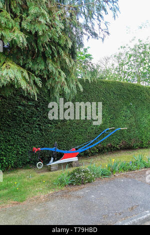 Old hand operated ploughshare as garden ornament - Stock Image