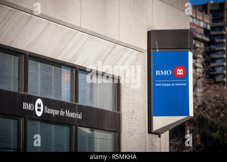 MONTREAL, CANADA - NOVEMBER 4, 2018: Bank of Montreal logo, known as BMO, in front of one of their branch. Called as well banque de Montreal, it is on - Stock Image