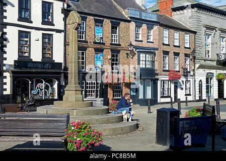 Man and dog, the Market Place, Knaresborough, North Yorkshire, England UK - Stock Image