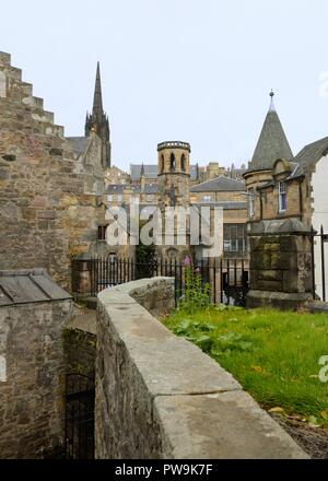 A mishmash of old sandstone buildings in Cowgate, Edinburgh's World Heritage Site, Scotland, UK, Europe - Stock Image