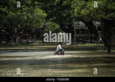 The flooded main street of Sit Pin Gyi village, Irrawaddy delta, Myanmar. - Stock Image