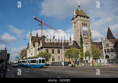 A tram passes the Swiss National Museum in Zurich Switzerland. The musuem details Swiss history and crafts - Stock Image