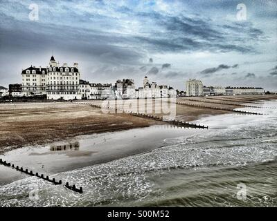 Dramatic view of Eastbourne seafront houses and beach, East Sussex, England. - Stock Image