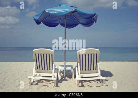 Relaxing white beach chairs in Phuket, Thailand - Stock Image