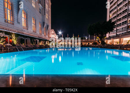Rio de Janeiro, Brazil, March 17, 2019: Poolside bar and lounge chairs at luxurious Copacabana Palace Belmond in Copacabana, Rio de Janeiro, Brazil - Stock Image