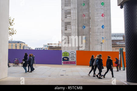 Construction site of Google's new King's Cross HQ headquarters  designed by Bjarke Ingels Group and Heatherwick Studios with people walking in front - Stock Image
