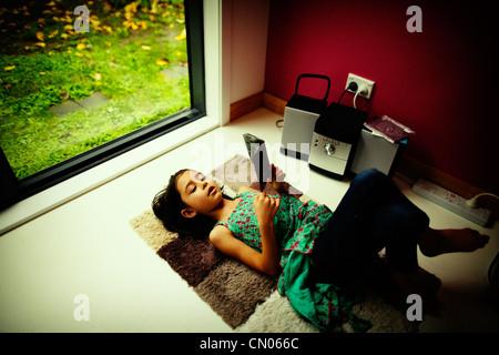 Girl listens to CD - Stock Image