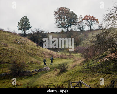 Young couple hiking on overcast day - Stock Image