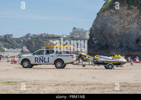 RNLI Lifeguard on duty at beach at Newquay, Cornwall - home of Boardmasters Festival. - Stock Image