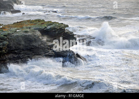 Porth-y-post is a small cove on the west coast of Holy Island, Anglesey here experiencing stormy weather. - Stock Image