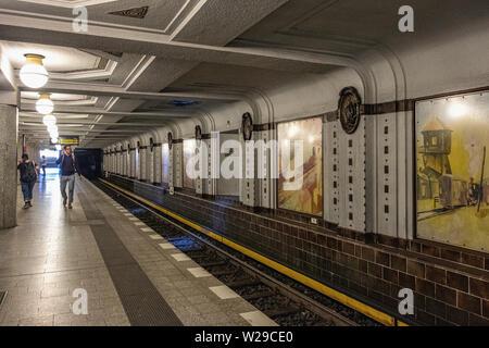 Berlin Dahlem District,Breitenbachplatz U-Bahn underground railway station interior, Platform, decorative tiles, medallions & old paintings. - Stock Image