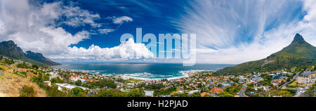 Camps Bay and Lion's Head mountain, amazing panoramic landscape of coastal city between two mountains, Cape - Stock Image