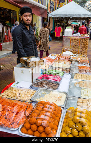 Sidewalk Vendor of Candy, Pastries, and Sweets, Brickfields, Little India, Kuala Lumpur, Malaysia. - Stock Image