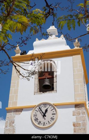 Portugal, Algarve, Alvor, Manueline Church Clocktower - Stock Image
