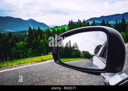 Beautiful landscape from car window on mountain road. Summer traveling by car - Stock Image