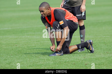 Brazilian Naldo laces his shoes during the practice session of Bundesliga club Werder Bremen at Weserstadium in - Stock Image