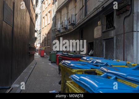 Industrial refuse bins in Birmingham Alleyway. - Stock Image