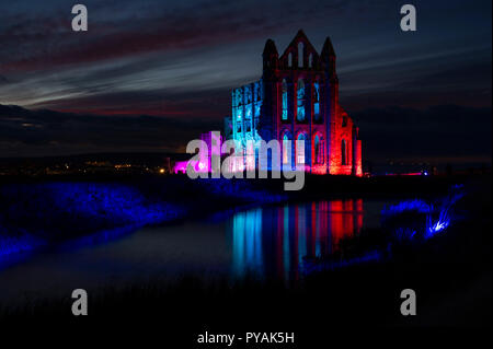 Illuminated Whitby Abbey in Whitby, North Yorkshire - Stock Image