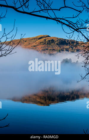 Silver How reflections at a misty Grasmere, Lake District, Cumbria - Stock Image