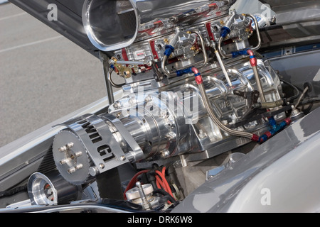 Massive supercharger on top of a heavily modified V8 custom car engine. - Stock Image