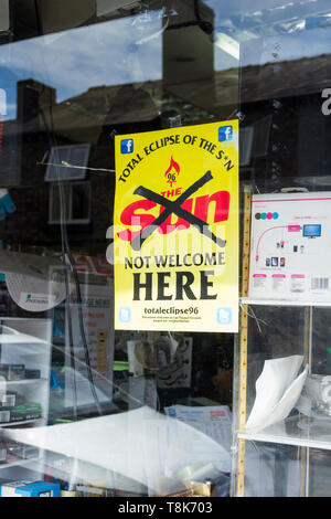 Totaleclipse96 sign in a newsagent shop window, Woolton, Liverpool. 'The Sun Not Welcome Here' is a slogan of the 'TotalEclipseoftheS*n' campaign. - Stock Image