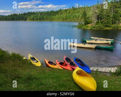 Kayaks and canoes on a lake in Fundy National Park New Brunswick Canada - Stock Image