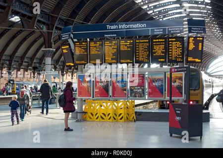 Arrival and departure train information sign boards at the railway station York North Yorkshire England UK United Kingdom GB Great Britain - Stock Image