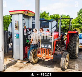 CLARKSVILLE, TN,  USA-29 MAY 18: A young rural couple buy diesel fuel  for their 231 Massey-Ferguson tractor at a credit card pump. - Stock Image