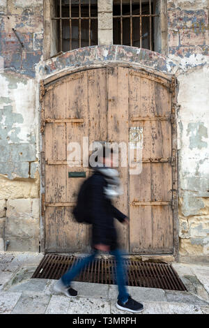old derelict buildings in the Victoria Gate area of Valletta, Malta that are now being refurbished. - Stock Image