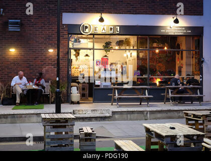 External view of Pearl Hackney Wick, bar and cafe in East London, after dark - Stock Image