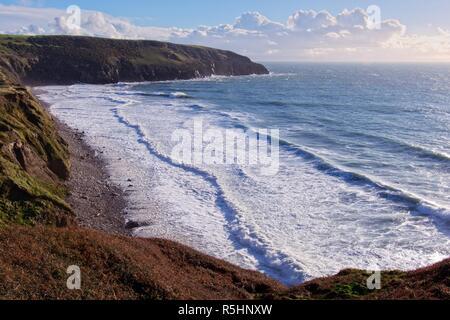 Waves crashing onto Porth Ceiriad Beach, near Abersoch, Gwynedd, Wales - Stock Image