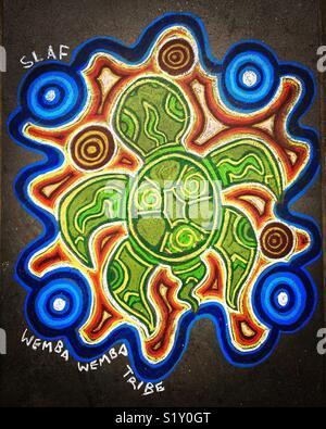 Aboriginal Indigenous Australian chalk art or turtle on sidewalk - Stock Image