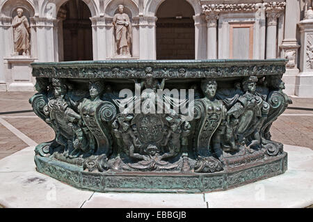 Elaborately sculpted bronze well or vera di pozzo in courtyard of Palazzo Ducale or Doges Palace Venice Italy - Stock Image